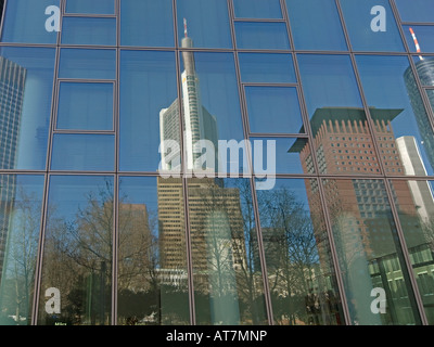 reflections of Japan Center and Commerzbank on facade of the bank office tower of Dresdner Bank Galileo in Frankfurt - Stock Photo