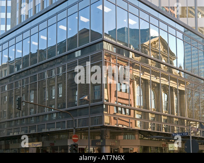 reflections of an old building on storefront of a bank office tower Frankfurt am Main Hesse Germany - Stock Photo