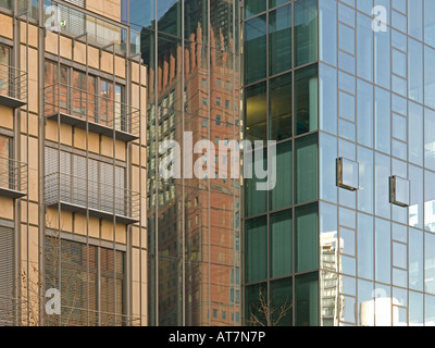 reflections on facade with bank office towers of Japan Center Frankfurt am Main Hesse Germany - Stock Photo