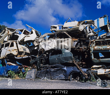 Wrecked cars piled up in scrapyard, Guadeloupe, French West Indies - Stock Photo