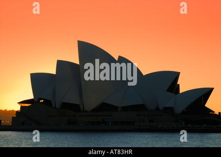 Sydney Opera House at sunrise, Sydney, New South Wales, Australia - Stock Photo