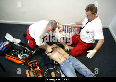 DEU, Germany : Rescue, paramedics in a private home, attempt at resuscitation, after a cardiac arrest. Training - Stock Photo
