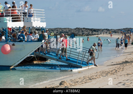 Passengers from cruise ship step out on the bank of the Bahamas  Island Great Stirrup Cay for one day  rest - Stock Photo
