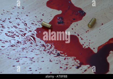 murder scene with blood and bullet casings on the floor - Stock Photo