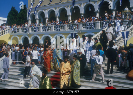 popes in colorful vestments staircase of th church in Tinos feast of Panagia pilgrimage cyclades Greece - Stock Photo