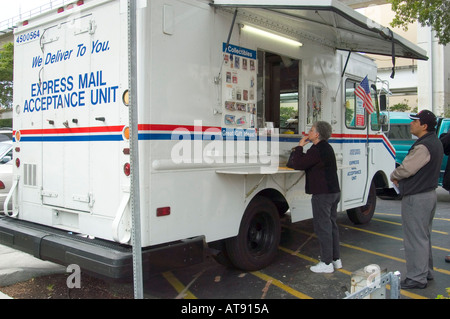 Miami Florida Street Life US Postal Service sells stamps from mobile truck - Stock Photo