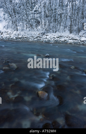 Crisp, winter scene of the flowing waters of the River Arve, Chamonix, France - Stock Photo
