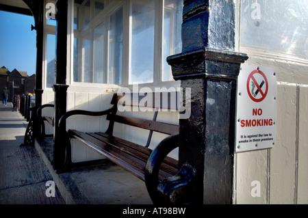 A No Smoking sign on a beach side promenade shelter on the seafront in Hastings East Sussex UK - Stock Photo