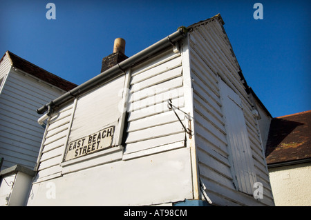 A small wooden house boarded up for the Winter in East Beach Street on the seafront in Hastings East Sussex UK - Stock Photo