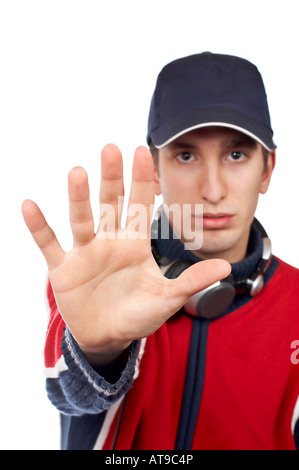 Serious disc jockey saying stop over a white background Hand in focus - Stock Photo
