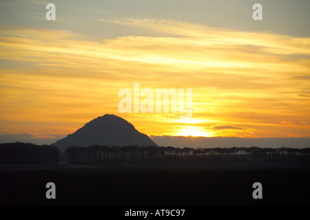 Sunset behind hill of Berwick Law North Berwick East Lothian Scotland - Stock Photo