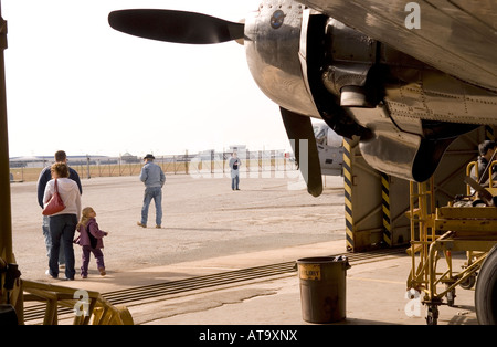 Little Girl Turns to Look Back at Plane in Hanger at Carolinas Aviation Museum in Charlotte NC USA - Stock Photo