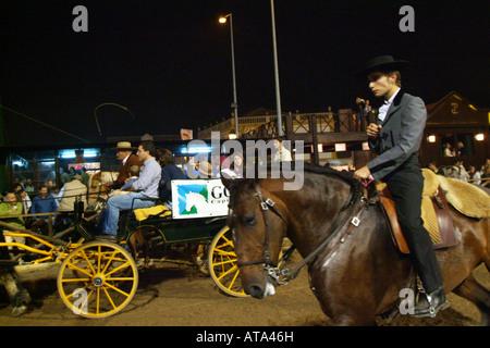 Man in horse at night in Golega, Portugal - Stock Photo