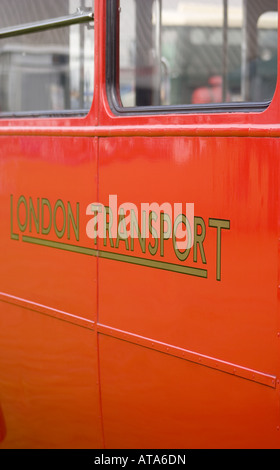 Side of London bus showing livery transport red route master vintage old collector panel windows - Stock Photo