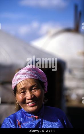A Mongolian greets visitors outside her camp near Ulan Bator Mongolia - Stock Photo