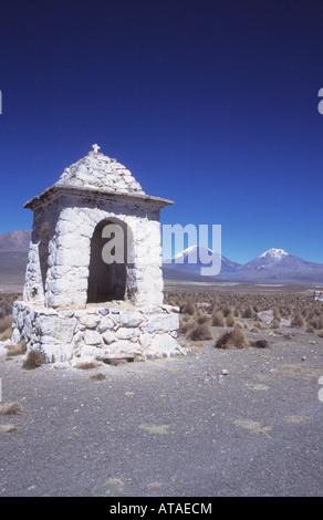 Cairn near Lagunas, Payachatas volcanoes in background, Sajama National Park, Bolivia - Stock Photo