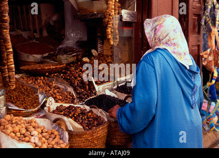 Moroccan woman, buying, dates, figs, nuts, shopping, medina, Fes el-Bali, city of Fez, Morocco - Stock Photo
