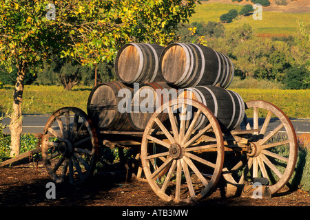 Barrels And Wagon Wheels Outside An Old Irish Farm Cottage