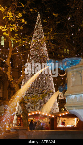 Christmas in Albert Square, Manchester.  A Christmas Tree and the Victoria Jubilee Fountain. - Stock Photo