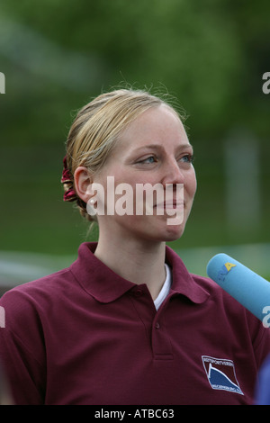 Portrait up of a happy young lady interviewed after a successful Voltige tournament in Regensburg Bavaria Germany - Stock Photo