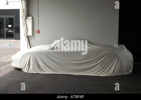Porsche Carrera GT covered with fabric in a Porsche factory, Leipzig, Germany - Stock Photo