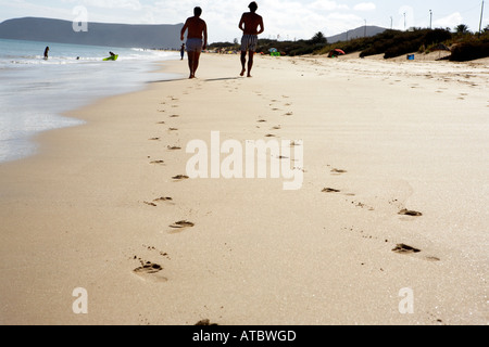 Footsteps in the sand on the beach in Porto Santo - Stock Photo