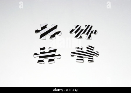 Striped puzzle pieces, close-up - Stock Photo