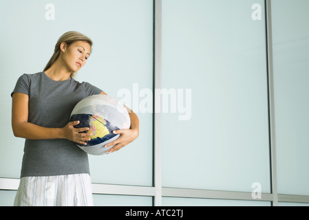 Woman holding bandaged globe - Stock Photo