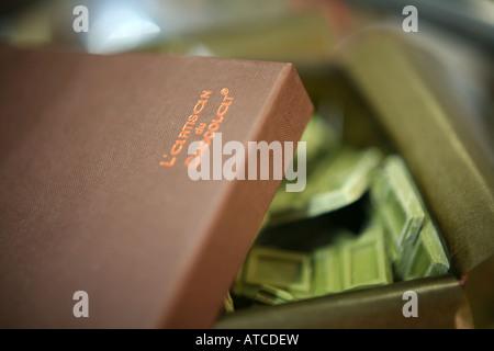 Green Tea chocolate in L'Artisan du chocolat luxury handmade chocolate shop on Lower Sloane Street Chelsea london - Stock Photo