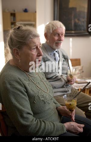 elderly czech couple at home in prague czech republic - Stock Photo