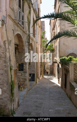 Typical narrow street in the Haute Ville (Old Town), Bonifacio, Corsica, France - Stock Photo
