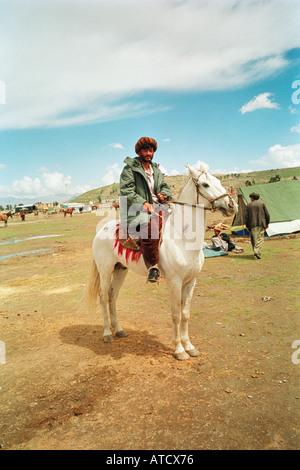 Buzkashi player and pony, Kabul, Afghanistan. - Stock Photo