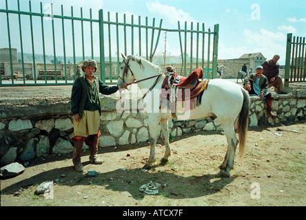 Hazar groom and Buzkashi pony, Kabul, Afghanistan. - Stock Photo