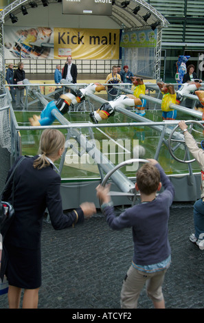 Business woman with her young son at the oversized table soccer in Neue Kranzler Eck. Charlottenburg, Berlin, 2005. - Stock Photo