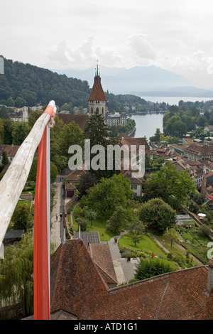 Stadtkirche and view of Alps in distance from Schloss Thun Thun Switzerland - Stock Photo
