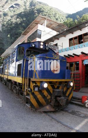 Passenger train arriving at Machu Picchu Pueblo station, Aguas Calientes, Peru - Stock Photo