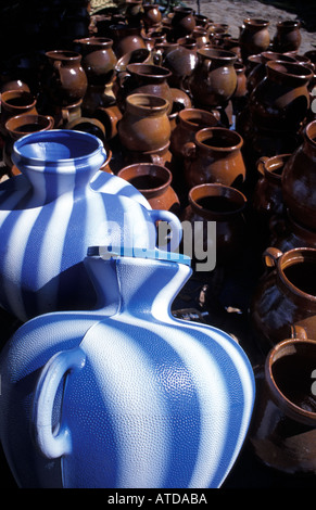 Selection of modern and traditional water jugs for sale at market Chichicastenango Guatemala - Stock Photo
