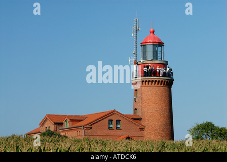 Tourists enjoying the view from the old lighthouse in Bastorf near Kuehlungsborn, Western-Pomerania, Germany - Stock Photo