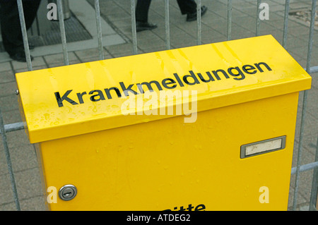 Letter box on an entrance of a factory for sick certificate - Stock Photo