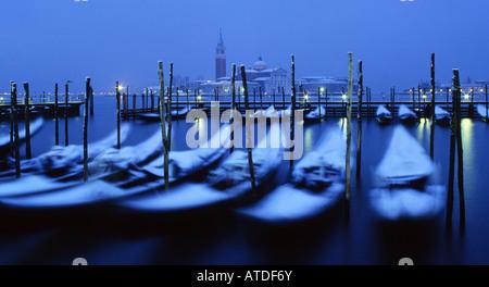 Venice in snow View over gondolas on Molo to San Giorgio Maggiore at night Venice Veneto Italy - Stock Photo
