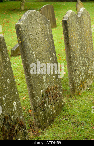 Gravestones in St. Peter and St. Mary parish church cemetery Stowmarket Suffolk East Anglia - Stock Photo