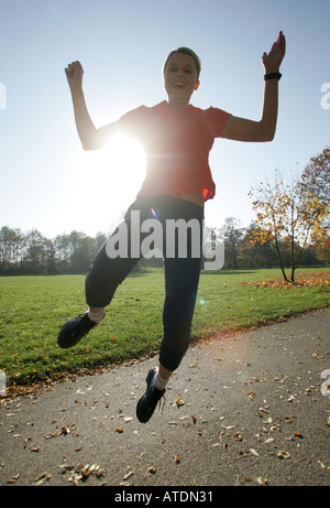 young woman leaping high - Stock Photo