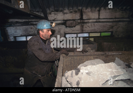 Miner working in a mine in Gliwice, Poland - Stock Photo