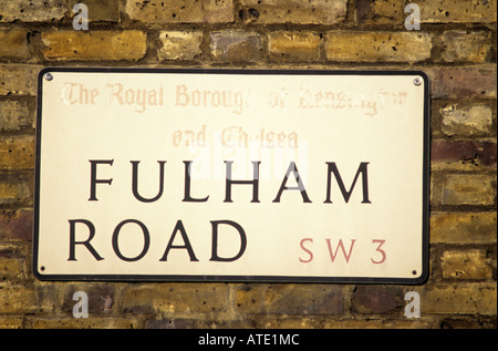 STREET SIGN OF FULHAM ROAD ON YELLOW BRICK WALL LONDON ENGLAND - Stock Photo