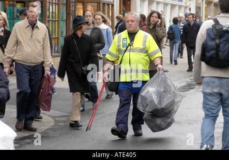 Street cleaner in Cornmarket Street Oxford - Stock Photo