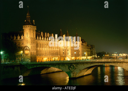 A view at night from the opposite side of the river of La Conciergerie a building on the Ile de Cite which has spent - Stock Photo