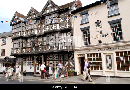 Exterior of The Feathers Hotel with visitors walking past during the annual Ludlow Food Festival Shropshire England - Stock Photo