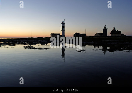 Lighthouse island in the summer night - Stock Photo