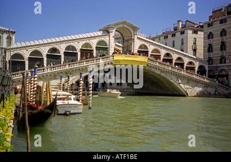 Venetian architecture with Rialto Bridge Great Canal & gondolas Venice Veneto Northeast Northern Italy Europe - Stock Photo