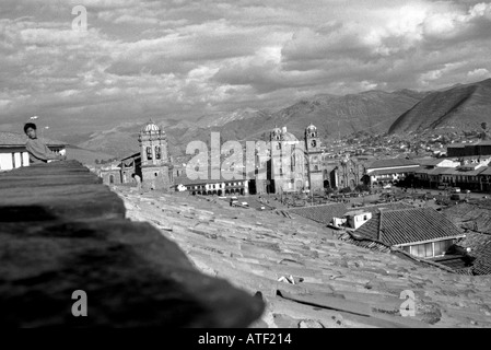 Panoramic view colony town house church cathedral dominate square roof tile mount cloud sky Cuzco Peru South Latin - Stock Photo